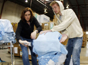 Project C.U.R.E. volunteers packing medical equipment bound for Tanzania.