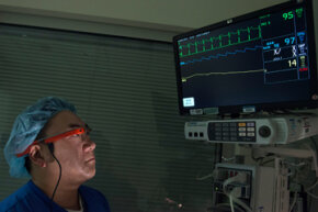 An anesthesiologist, Dr. Patrick Hu, uses Google Glass to share EKG data with other doctors as part of a pilot program at UC Irvine in 2013. Medical professionals from around the world may soon use Glass to collaborate on patient care.