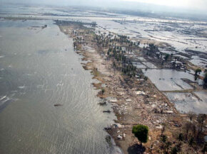Six weeks after the 2004 tsunami, one can barely tell where the sea ends and the Banda Aceh shoreline begins.