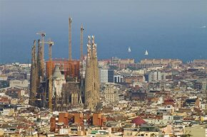 The Sagrada Familia cathedral in Barcelona towers over the city. It's been in construction since 1883.