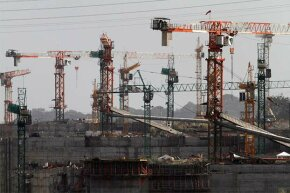 Idle cranes are seen at the construction site of the Panama Canal Expansion project on the outskirts of Colon City, Feb. 12, 2014. The project is already a $1 billion over budget.