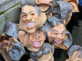 "Rubber Tony Blair masks are discarded in London after being worn to promote the TV show ""The Trial of Tony Blair."" These masks' exaggerated features are clearly a caricature of the former prime minister."
