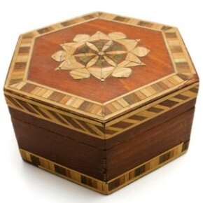 Never use force to move a puzzle box piece. If it's supposed to move, it will move easily.