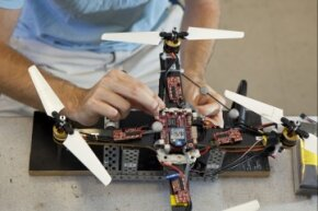 Graduate student Mark Cutler, in MIT's Department of Aeronautics and Astronautics, works on a quadrotor - on Sept. 27, 2011, in Cambridge, Mass.