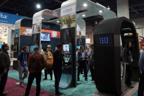 Attendees visit the FitBit booth at the 2014 International CES at the Las Vegas Convention Center. FitBit makes devices that allow you to monitor your sleep patterns, calorie intake and activity level. See more everyday tech pictures.