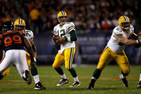 Aaron Rodgers, of the Green Bay Packers, prepares to pass in a 2010 game against the Chicago Bears.