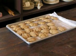 Using a good cookie sheet and lining it with parchment paper is an easy way to improve your cookie production.