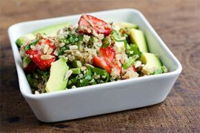 Here's a nutrient-rich salad comprising quinoa, strawberries, avocados and spinach.