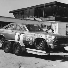 In the good old days, most drivers towed their race cars on open flatbed trailers like this one.