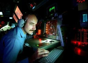 Operation Specialist 2nd Class Gilbert Lundgren operates radar equipment in the combat information center of the USS Carney.