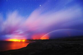 A moonbow appears near dawn in Hawaii.