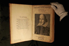 "A Sotheby's employee (very, very carefully) displays a first edition of William Shakespeare's ""First Folio"" before auction in 2006."