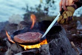 Image Gallery: Grilling Steak, Step-by-Step Rare, but not raw. Even in the wilderness, you should cook the meat you kill. See more steak grilling pictures.