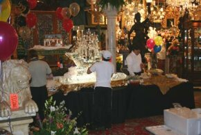 Red Baron's Antiques catering crew puts the final touches on the buffet served the night of the preview party.