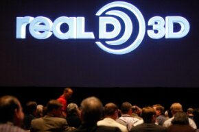 You've probably seen the RealD logo on the screen at your local movie theater.