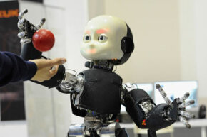 A humanoid robot plays ball at the 2012 Robotica Humanoid and Service Robots Expo in Milan, Italy in November 2012. See More Robot Pictures.