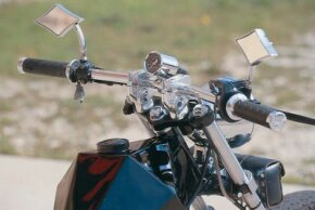 The Rebel's mirrors and handlebars display distinct features.