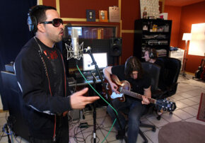 Many recording engineers start out as musicians. Singer Malverde, standing, rehearses with engineer Eric J. Dubowsky, playing guitar.