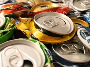 Don't just smash 'em and stash them in the recycling bin. Instead, repurpose aluminum cans into creative crafted items.