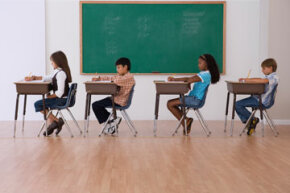 What are some of the signs that a fifth grader should repeat the year?