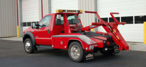 Repo men use repo trucks, like this self-loading wrecker, that can hookup a car and drive off in about 10 seconds. See more truck pictures.