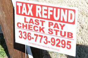 This sign in Burlington, North Carolina, advertises tax-refund-anticipation loans. Tax refund fraud by identity theft is endemic in the U.S. Thieves use matching names and Social Security numbers to get refunds of people they impersonate.
