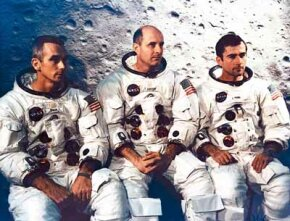 The three primary crew members for the Apollo 10 mission (Eugene A. Cernan, Thomas P. Stafford and John W. Young) pose in front of a large map of the lunar surface. They launched on May 18, 1969.