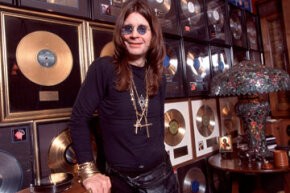 Ozzy Osbourne posing at home with his gold discs.