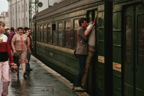 Two men force their way through the closing doors of a commuter train at Leningrad Station in Moscow in 1987.
