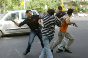 Two pedestrians fight a driver and his passenger after a near-collision in New Delhi, India. Road rage is a dangerous behavior pattern that can affect any of us at any given time.  See more car safety pictures.