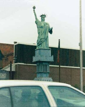 The Junk Statue of Liberty in McRae, Georgia, was fashioned partly out of a tree stump, Styrofoam, and green paint.