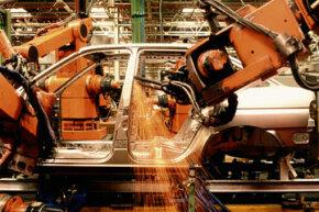 Automatons building automobiles