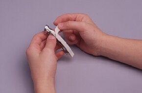 ©2007 Publications International, Ltd.                              Gently press the ribbon onto the surface of the barrettes.