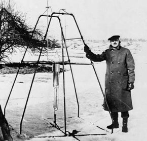 Dr. Robert H. Goddard and his liquid oxygen-gasoline rocket in the frame from which it was fired on March 16, 1926, at Auburn, Mass. It flew for only 2.5 seconds, climbed 41 feet, and landed 184 feet away in a cabbage patch.