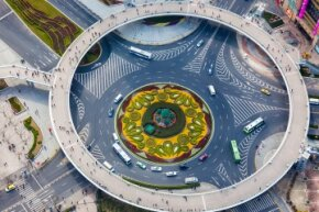 This Shanghai, China, roundabout features a pedestrian circle hovering above it.