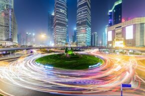 A roundabout in Shanghai, China's financial district glows at night.