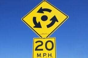 Simply proceed with caution, yield to traffic in the roundabout and follow the signs, and you should be fine.