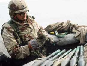 Capt. Jose R. Atencia, 77th Explosive Ordnance Disposal Unit, handles abandoned Iraqi RPG-7 High Explosive Anti-Tank (HEAT) rockets in the aftermath of Operation Desert Storm.
