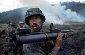 An Ecuadoran commando checks the back blast area before firing an M-72 light anti-armor weapon (LAW) during small unit training conducted as part of the joint Ecuadoran/U.S. exercise Blue Horizon '86.