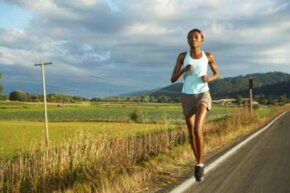 Keep your head up and look toward the horizon to boost your running posture.