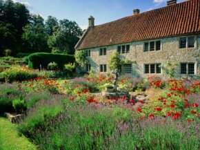House in gardens, English countryside.