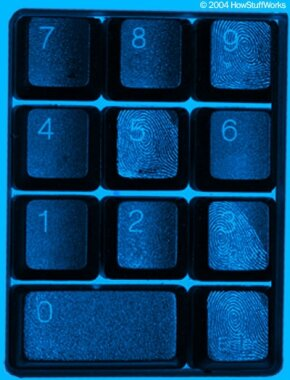 Ultraviolet fingerprints provide a trail for the safecracker to follow.