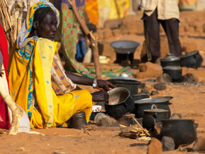 The harsh environmental conditions of the Sahel contribute to the region's strife: A woman who fled fighting prepares tea at a shelter in North Darfur, Sudan.