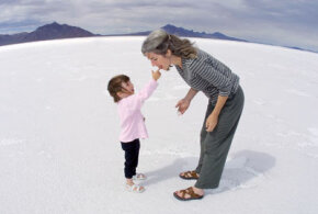 Shannon Loitz gives her mother, Cheryl, a taste from the Bonneville Salt Flats in Utah. See more salt pictures.