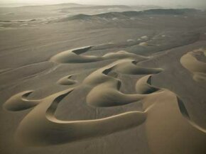 Crescent-shaped sand dunes in Namibia