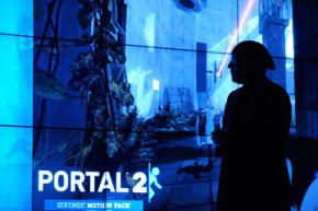Intel executive Mooly Eden demonstrates Sandy Bridge's graphics processing capability with a demo of Portal 2 at CES 2011. See more computer hardware pictures.