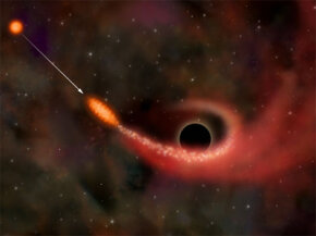 A supermassive black hole ripping apart a star and consuming a portion of it.