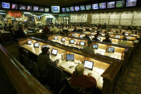 Enthusiasts gather in the sports book inside the Green Valley Ranch Resort and Spa in Las Vegas on Jan. 15, 2005. Sports books see an enormous rise in traffic during March Madness.