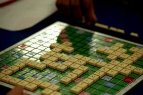 Scrabble is a word game that relies on both vocabulary knowledge and chance.