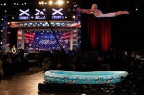 """Darren Taylor, who goes by the stage name """"Professor Splash,"""" performs an extreme shallow high dive while auditioning for """"America's Got Talent"""" in 2011."""